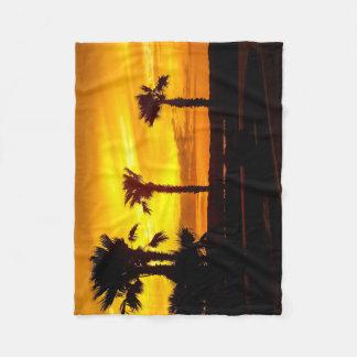 Nascer do sol da praia cobertor de velo