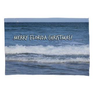 Natal alegre de Florida sobre o oceano