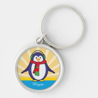 Natal bonito do pinguim com seu nome chaveiro