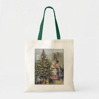 Natal vintage, família do Victorian em torno da Bolsas