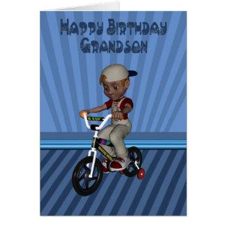 Neto do feliz aniversario, menino em uma bicicleta cartão