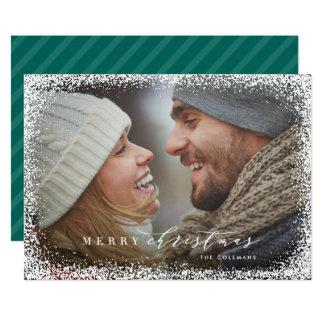 Nevado no cartão do feriado do Feliz Natal