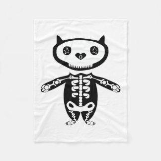 Noite com esqueleto do gato cobertor de lã