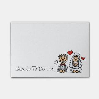 Noivo para fazer a nota do lembrete do planejador post-it notes