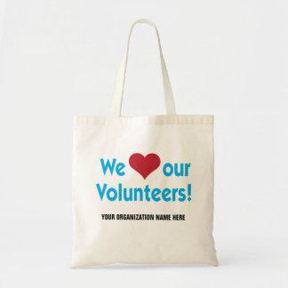 Nós amamos nossos voluntários com símbolo do bolsa tote