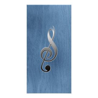 Nota de madeira azul abstrata do clef da música da cartão com foto