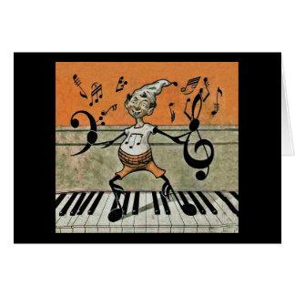 Nota musical do duende no cartão de nota do piano