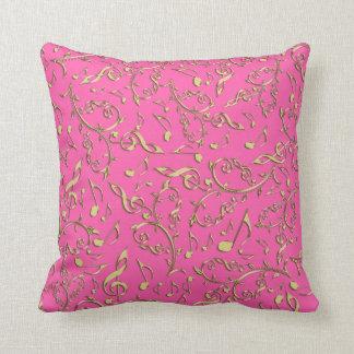 Notas da música do ouro no rosa quente ou na sua almofada