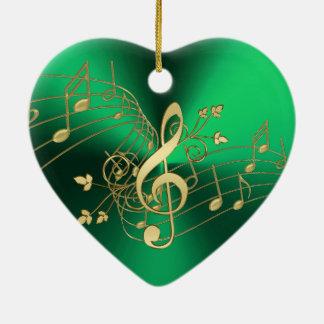 Notas da música e enfeites de natal verdes do Clef