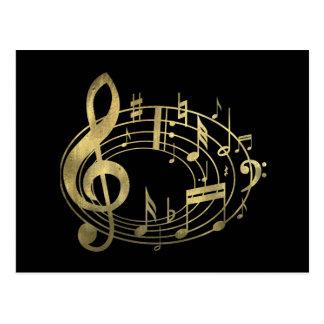 Notas musicais douradas na forma oval cartões postais