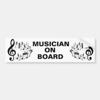 Notas musicais pretas na forma oval adesivo