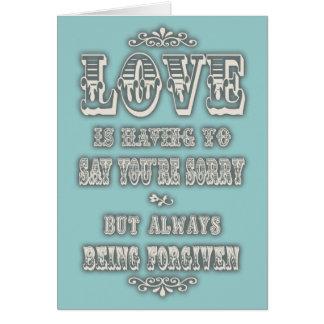 O amor está dizendo cartão comemorativo