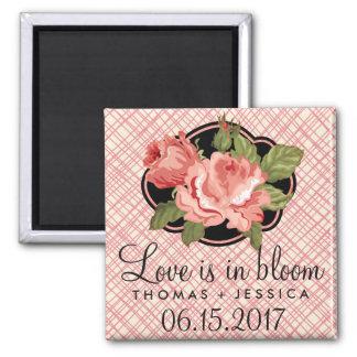 O amor está em ímãs cor-de-rosa da data das ímã quadrado