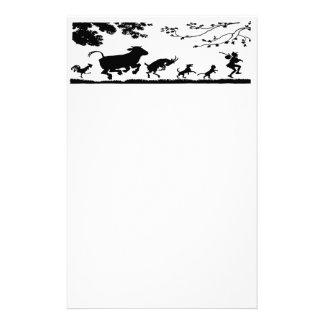 O animal mostra em silhueta artigos de papelaria