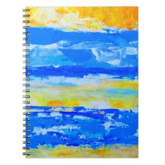 O artista de paisagem da praia projetou o caderno