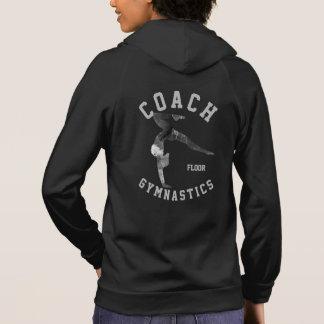 o assoalho da ginástica treina a jaqueta