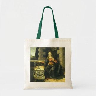 O aviso por Leonardo da Vinci Bolsas