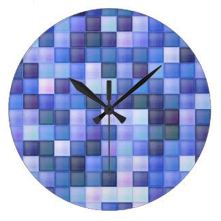 O azulejo azul do banheiro esquadra o teste padrão relógios de paredes