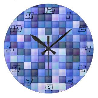 O azulejo azul do banheiro esquadra o teste padrão relógios de pendurar