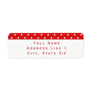 O bastão de doces pontilha a etiqueta de endereço