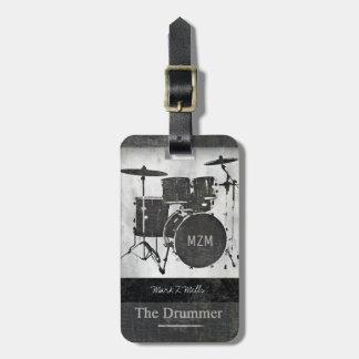 o baterista do viagem da banda etiqueta de bagagem