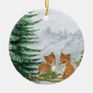 O bebê Foxes o ornamento das madeiras da árvore de
