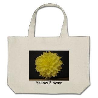 O bolsa amarelo da flor