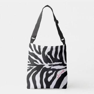 O bolsa animal preto e branco da forma do