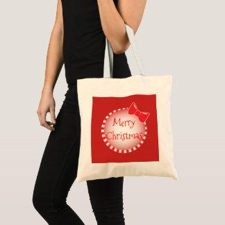 O bolsa básico vermelho do Feliz Natal | do arco