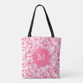 O bolsa cor-de-rosa do monograma do teste padrão