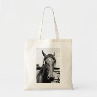 O bolsa da cabeça de cavalo preto e branco