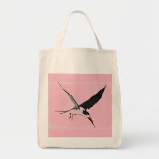 O bolsa da compra do Skimmer - rosa no fundo