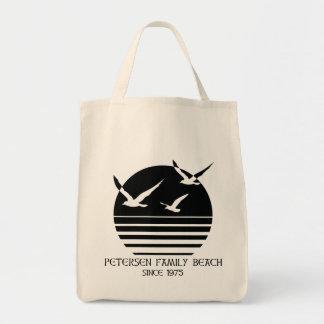 O bolsa do cliente da praia da família de Petersen