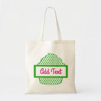 O bolsa do cupcake das bolinhas no verde