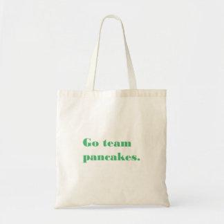 O bolsa do slogan - vão as panquecas da equipe