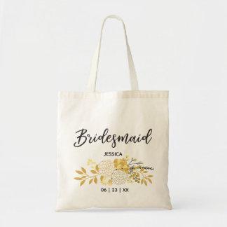 O bolsa floral do ouro e da dama de honra do