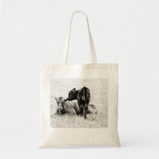 O bolsa preto & branco do bebê da vitela do