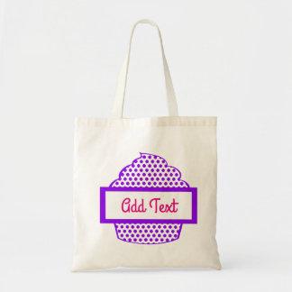O bolsa roxo do cupcake das bolinhas