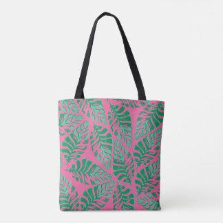 O bolsa verde e cor-de-rosa colorido das folhas