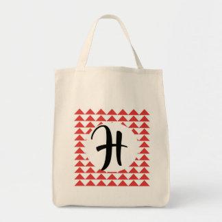 O bolsa vermelho do monograma do ziguezague