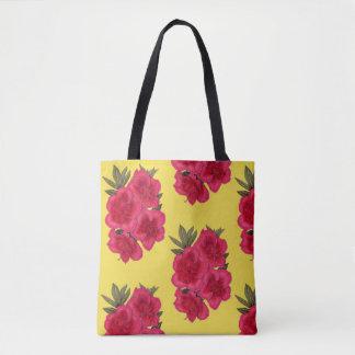 O bolsa vermelho e amarelo da compra da flor da