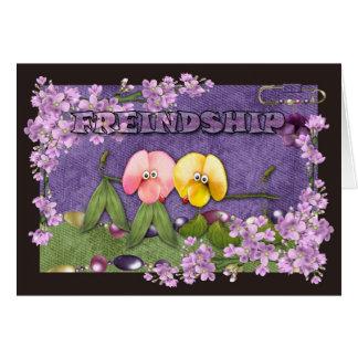 O cão pequeno da amizade floresce bonito cartão comemorativo