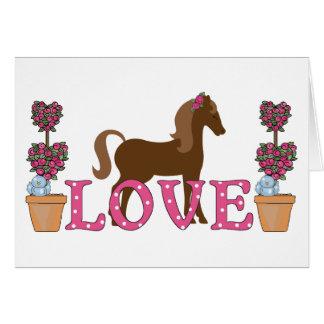 O cartão bonito do cavalo do amor dos pôneis