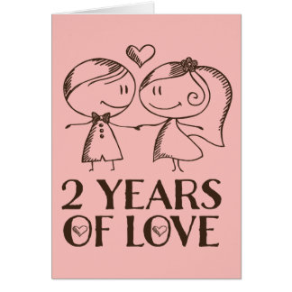 ò Cartão tirado mão do casal do aniversário