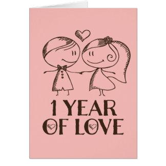 ø Cartão tirado mão do casal do aniversário