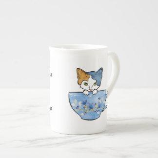 O chá do sorvo e Pet minha caneca de China do gato