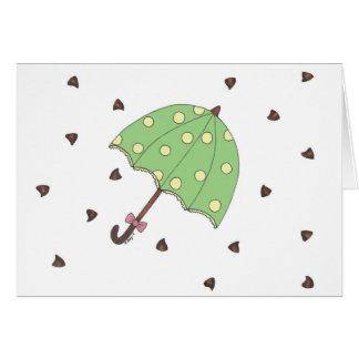 O chocolate rega o cartão do guarda-chuva dos