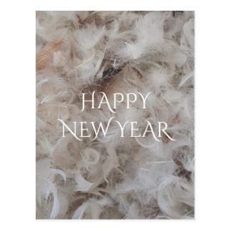 O cobertor do feliz ano novo para baixo empluma-se cartão postal
