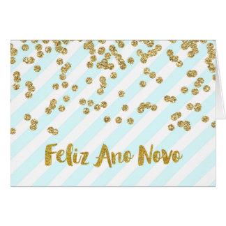O confete do ouro do feliz ano novo listra cartão comemorativo