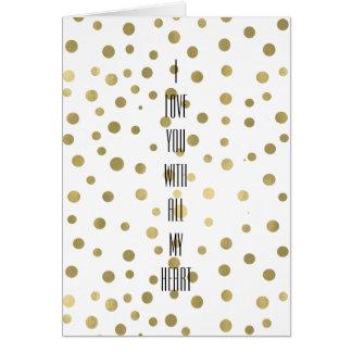 O confete do ouro pontilha o amor cartão comemorativo